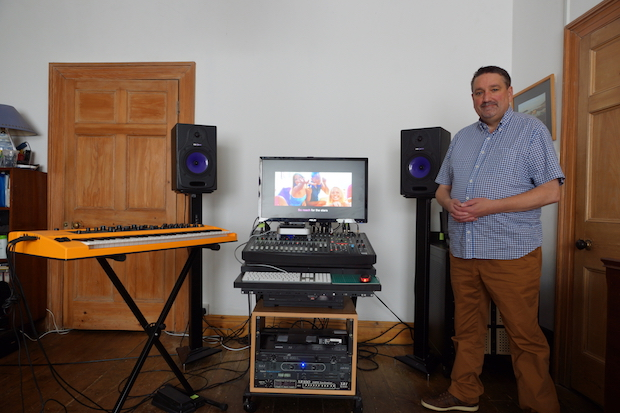 Andy at home with mixing desk, computer screen and HHB monitors.